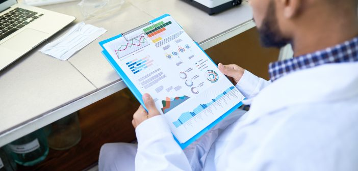 doctor looking at a health data chart